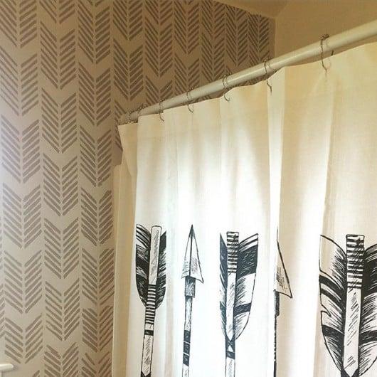 A DIY stenciled bathroom using the Drifting Arrows wall stencil pattern. http://www.cuttingedgestencils.com/drifting-arrows-stencil-pattern-diy-decor.html