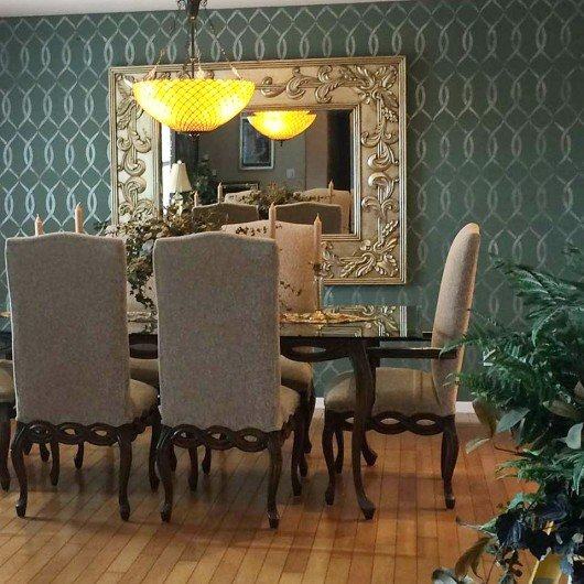 A DIY stenciled accent wall in a dark gray dining room using the Entwined Allover Stencil. http://www.cuttingedgestencils.com/stencil-pattern-2.html