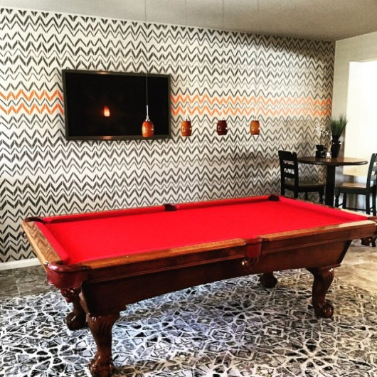 A DIY stenciled accent wall in a game room using the Retro Flame Allover Stencil. http://www.cuttingedgestencils.com/retro-stencil-pattern.html