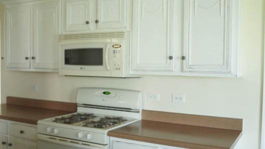 A before shot of a kitchen. http://www.cuttingedgestencils.com/herringbone-brick-pattern-stencil-wall-decor.html
