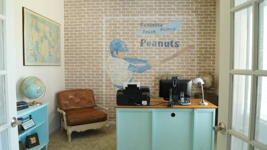 A DIY stenciled faux brick accent wall in a den using the Brick Allover Stencil. http://www.cuttingedgestencils.com/bricks-stencil-allover-pattern-stencils.html