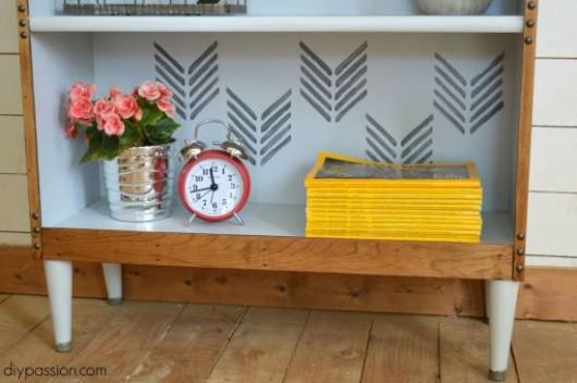A DIY thrift store bookshelf makevoer using the Drifting Arrows Allover Stencil. http://www.cuttingedgestencils.com/drifting-arrows-stencil-pattern-diy-decor.html