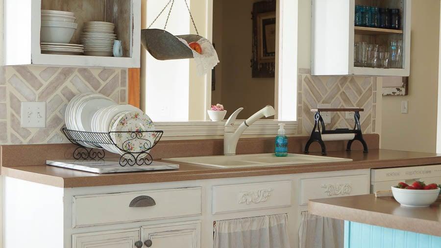A DIY stenciled kitchen backsplash using the Herringbone Brick Allover Stencil. http://www.cuttingedgestencils.com/herringbone-brick-pattern-stencil-wall-decor.html