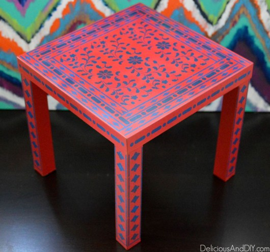 A DIY stenciled red and blue table using the Indian Inlay Stencil kit. http://www.cuttingedgestencils.com/indian-inlay-stencil-furniture.html