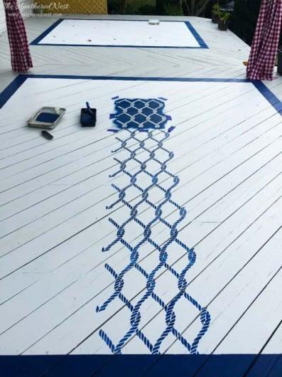 Stenciling an outdoor rug using the Perfect Catch Allover Stencil. http://www.cuttingedgestencils.com/perfect-catch-stencil-beach-decor.html