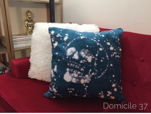 A DIY bleached and stenciled accent pillow using the Skull 1 Pillow Stencil Kit. http://www.cuttingedgestencils.com/skull-accent-pillows-for-diy-halloween-home-decor.html