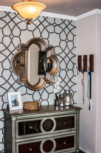 A DIY stenciled accent wall in an entryway using the Coco Trellis Allover Stencil. http://www.cuttingedgestencils.com/coco-trellis-allover-pattern-stencil.html