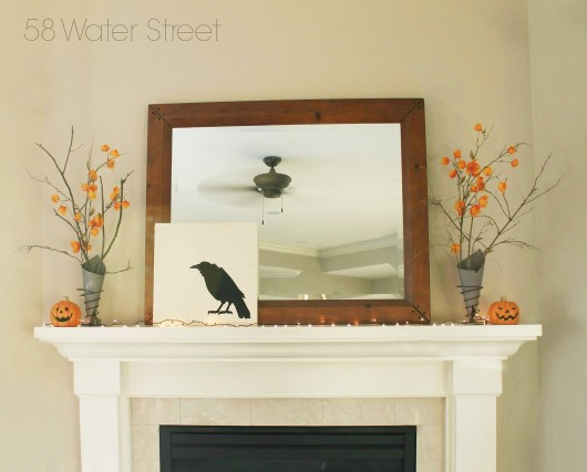 DIY stenciled Halloween mantel art using the Crow Craft Stencil on a canvas. http://www.cuttingedgestencils.com/crow-stencil-halloween-accent-pillows-trick-or-treat-totes.html