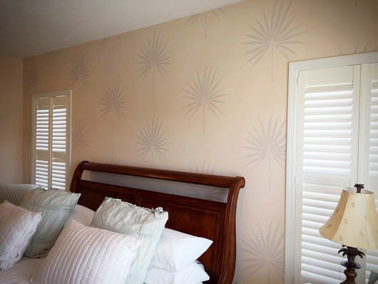 A DIY stenciled bedroom accent wall using the Palmetto Leaf Wall Art Stencil. http://www.cuttingedgestencils.com/palm-leaf-stencil-palmetto-wall-decor.html