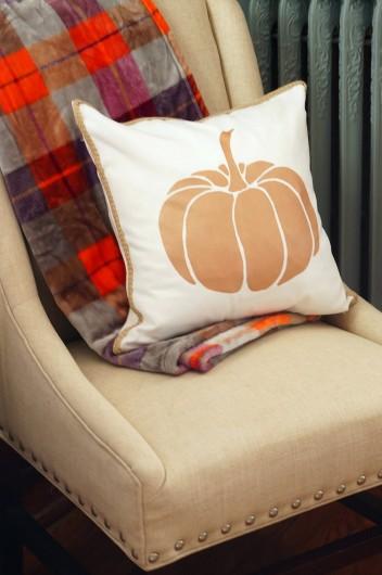 A DIY stenciled Fall accent pillow using the Pumpkin Stencil Kit from Cutting Edge Stencils. http://www.cuttingedgestencils.com/pumpkin-stencils-halloween-throw-pillows-diy-home-decor.html