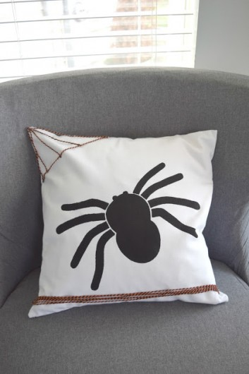 A DIY stenciled Halloween accent pillow using the Spider Stencil Kit. http://www.ourhousenowahome.com/2015/10/october-create-and-share-spider-pillow.html
