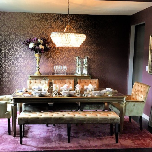 A DIY stenciled accent wall in a purple dining room using the Anna Damask Stencil from Cutting Edge Stencils. http://www.cuttingedgestencils.com/damask-stencil.html
