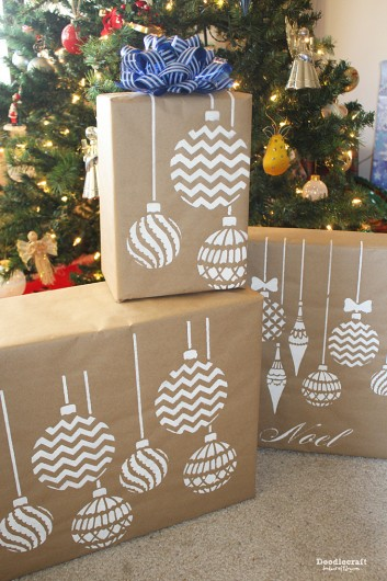 DIY stenciled gift wrap using the Christmas Ornaments Stencil from Cutting Edge Stencils and Kraft paper. http://www.cuttingedgestencils.com/diy-christmas-decor-craft-and-furniture-stencils.html