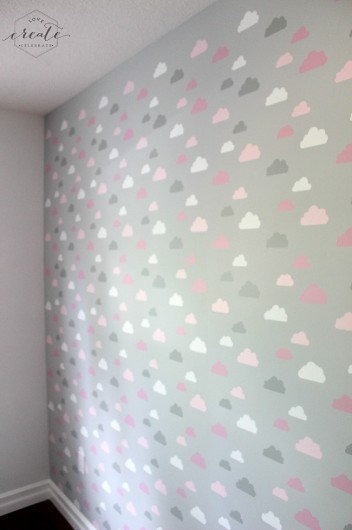 A DIY stenciled accent wall in a nursery using the Cloud Allover Stencils. http://www.cuttingedgestencils.com/clouds-allover-stencil-pattern-for-walls.html