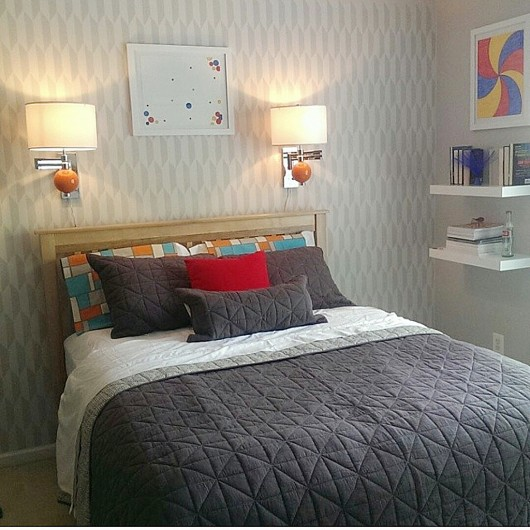 A DIY stenciled accent wall in a gray bedroom using the Prism Allover Stencil. http://www.cuttingedgestencils.com/prism-stencil-geometric-wall-pattern.html
