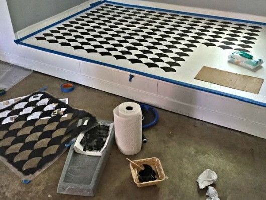 Stenciling a DIY garage floor using the Fishscale Allover Stencil from Cutting Edge Stencils. http://www.cuttingedgestencils.com/pattern-stencil-1.html