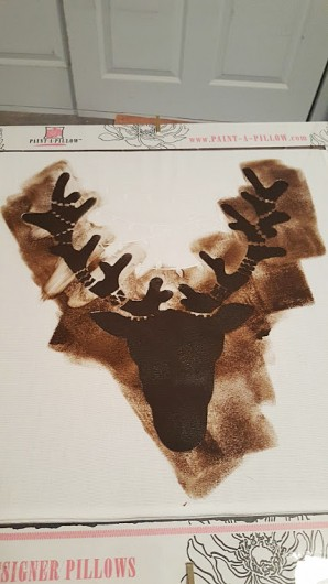 Stenciling a DIY Holiday inspired accent pillow using the Reindeer Paint-A-Pillow kit. http://www.cuttingedgestencils.com/reindeer-diy-accent-pillows-holiday-home-decor.html