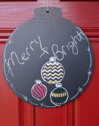 A DIY stenciled chalkboard door hanger using the Christmas Ornaments Card Stencil from Cutting Edge Stencils. http://www.cuttingedgestencils.com/christmas-ornaments-card-making-stencil-design.html