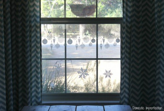 DIY stenciled windows using the Christmas Ornaments Stencil from Cutting Edge Stencils. http://www.cuttingedgestencils.com/diy-christmas-decor-craft-and-furniture-stencils.html