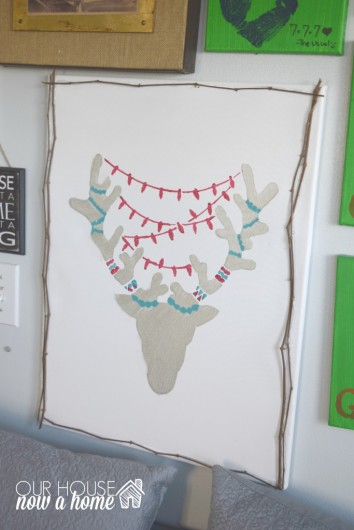 A DIY stenciled canvas art using the Reindeer Craft Stencil from Cutting Edge Stencils. http://www.cuttingedgestencils.com/reindeer-holiday-stencil-designs-for-diy-crafts.html