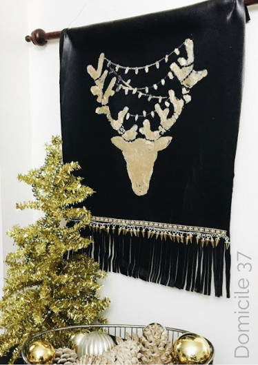 A DIY stenciled tapestry wall art using the Reindeer Craft Stencil from Cutting Edge Stencils. http://www.cuttingedgestencils.com/reindeer-holiday-stencil-designs-for-diy-crafts.html