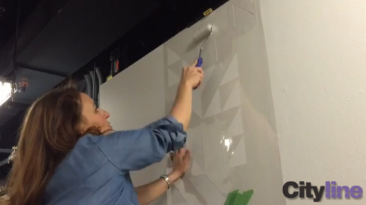 Stenciling an accent wall using the Shapes Allover Stencil from Cutting Edge Stencils on Cityline. http://www.cuttingedgestencils.com/shapes-allover-geometric-stencil.html