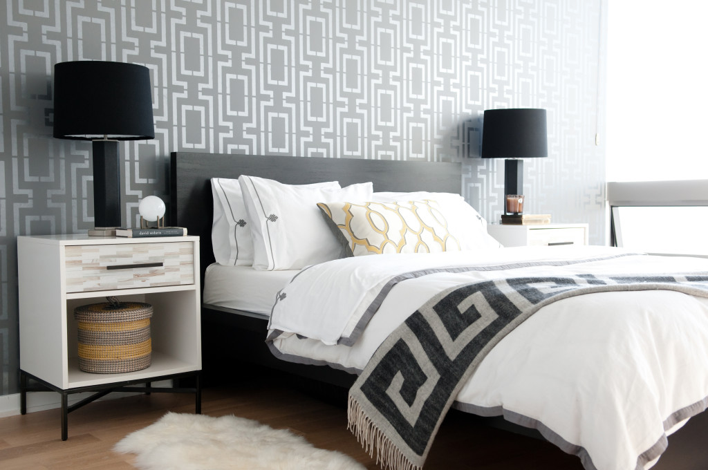 A DIY stenciled accent wall in a bedroom using the Connection Allover Stencil from Cutting Edge Stencils. http://www.cuttingedgestencils.com/wallpaper-stencil-connection.html