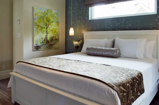 A DIY stenciled bedroom accent wall using the Flock of Cranes Stencil from Cutting Edge Stencils. http://www.cuttingedgestencils.com/bird-flock-wall-stencil-pattern.html