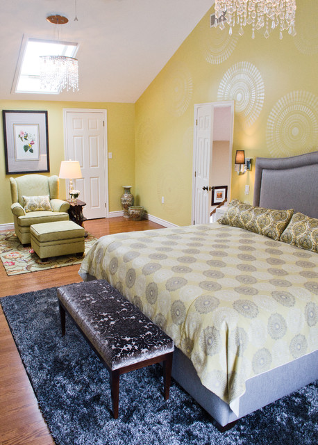 A DIY stenciled accent wall in a yellow bedroom featuring the Funky Wheel Stencil from Cutting Edge Stencils. http://www.cuttingedgestencils.com/funky-wall-stencils.html