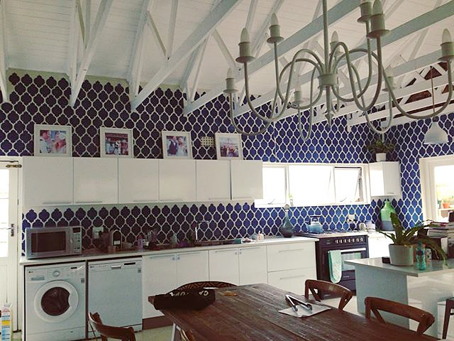 A blue and white DIY stenciled kitchen using the Casablanca Allover Stencil from Cutting Edge Stencils. http://www.cuttingedgestencils.com/allover-stencils.html