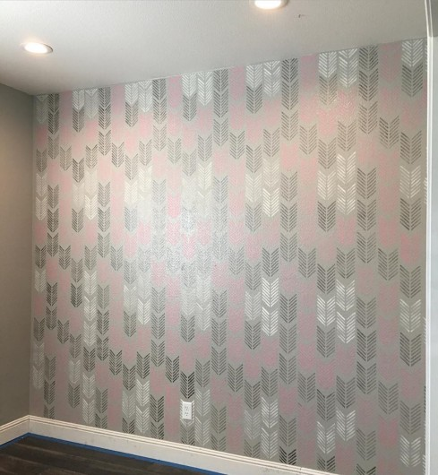 A DIY stenciled accent wall in a playroom using the Drifting Arrows Allover Stencil from Cutting Edge Stencils. http://www.cuttingedgestencils.com/drifting-arrows-stencil-pattern-diy-decor.html