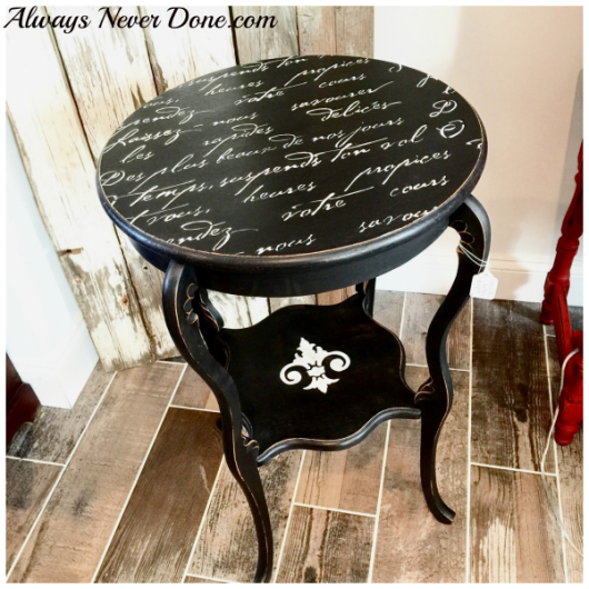 A stenciled DIY wooden table using the French Poem Craft Stencil from Cutting Edge Stencils. French Poem Craft Stencil from Cutting Edge Stencils. http://www.cuttingedgestencils.com/french-poem-diy-craft-stencil-design.html