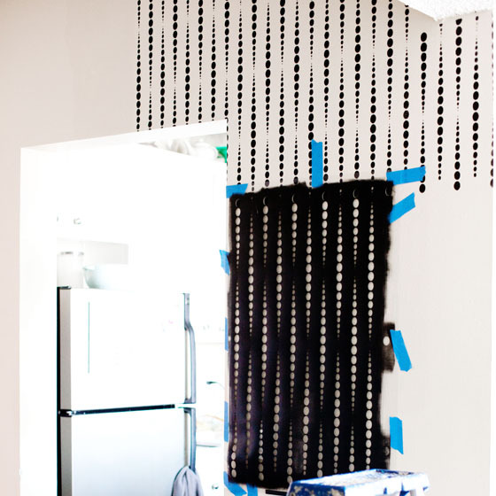 Stenciling a DIY wallpaper look in an entryway wall using the Beads Allover Stencil from Cutting Edge Stencils. http://www.cuttingedgestencils.com/beads-wall-stencil-pattern.html