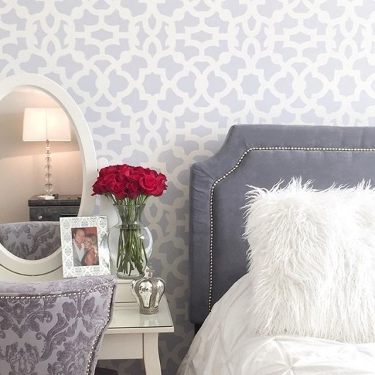 A DIY stenciled bedroom accent wall using the Zamira Allover Stencil from Cutting Edge Stencils in gray. http://www.cuttingedgestencils.com/moroccan-stencil-designs.html