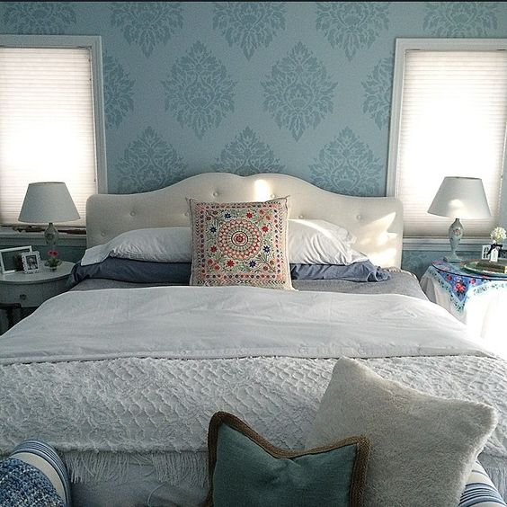 A DIY blue stenciled bedroom accent wall using the Nadya Damask Stencil from Cutting Edge Stencils. http://www.cuttingedgestencils.com/damask-moroccan-stencil.html