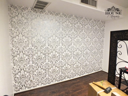 Stenciling a silver and white accent wall using the Anna Damask Stencil from Cutting Edge Stencils. http://www.cuttingedgestencils.com/damask-stencil.html