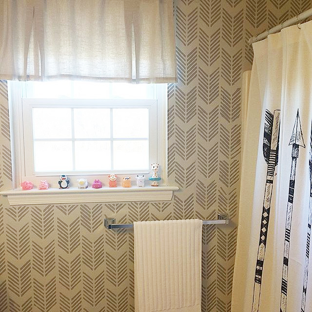 A DIY stenciled bathroom accent wall using the Drifting Arrows Allover Stencil from Cutting Edge Stencils. http://www.cuttingedgestencils.com/drifting-arrows-stencil-pattern-diy-decor.html