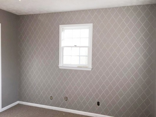 A DIY stenciled accent wall using the Harlequin Allover Stencil from Cutting Edge Stencils. http://www.cuttingedgestencils.com/trellis-stencil-harlequin.html