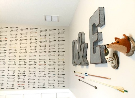 A DIY stenciled nursery accent wall using the Indian Arrows Allover Stencil from Cutting Edge Stencils. http://www.cuttingedgestencils.com/indian-arrows-stencil-pattern-for-walls.html