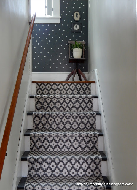 A DIY stenciled hallway accent wall in navy and white using the Little Diamonds Allover Stencil from Cutting Edge Stencils. http://www.cuttingedgestencils.com/little-diamonds-pattern-stencil-for-walls.html