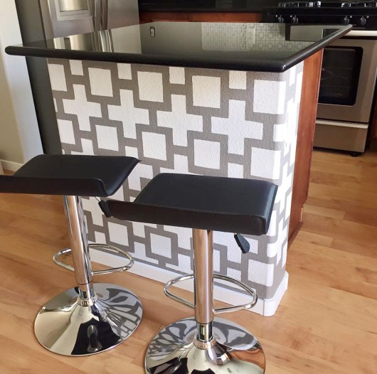 A gray and white modern stenciled kitchen island using the Square Plus Allover Stencil from Cutting Edge Stencils. http://www.cuttingedgestencils.com/geometric-stencil-pattern-square.html