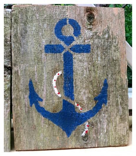 DIY stenciled wall art using reclaimed wood and the Anchor Stencil from Cutting Edge Stencils. http://www.cuttingedgestencils.com/beach-decor-anchor-stencil.html