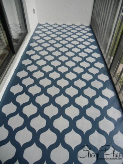 A DIY navy blue and white stenciled cement porch floor using the Cascade Allover Stencil from Cutting Edge Stencils. http://www.cuttingedgestencils.com/cascade-allover-stencil-pattern.html