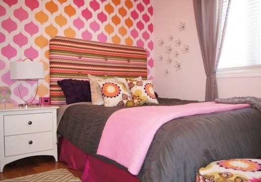 A DIY orange and pink ombre style stenciled accent wall in a girl's bedroom using the Cascade Allover Stencil from Cutting Edge Stencils. http://www.cuttingedgestencils.com/cascade-allover-stencil-pattern.html