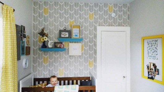 A DIY stenciled nursery accent wall in gray and yellow using the Drifting Arrows Allover Stencil from Cutting Edge Stencils. http://www.cuttingedgestencils.com/drifting-arrows-stencil-pattern-diy-decor.html