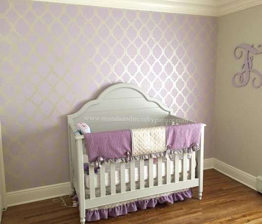 A DIY stenciled purple and cream stenciled nrusery accent wall using the Rabat Allover Stencil from Cutting Edge Stencils. http://www.cuttingedgestencils.com/moroccan-stencil-pattern-3.html