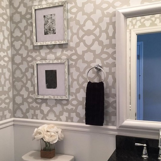 A DIY gray and white stenciled powder room using the Zamira Allover Stencil from Cutting Edge STencils. http://www.cuttingedgestencils.com/moroccan-stencil-designs.html