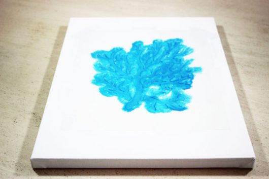 A stencil tutorial on how to paint DIY wall art using the Coral Stencil from Cutting Edge Stencils. http://www.cuttingedgestencils.com/beach-style-decor-coral-stencil.html