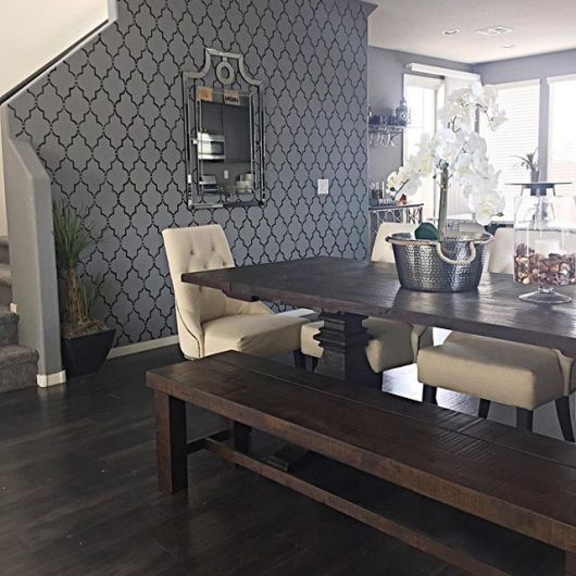 A DIY stenciled dining room accent wall in gray and black using the Marrakech Trellis Allover Stencil from Cutting Edge Stencils. http://www.cuttingedgestencils.com/moroccan-stencil-marrakech.html