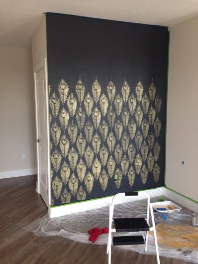 Stenciling an accent wall using Deep Onyx from Glidden and the Peacock Feather Allover Stencil from Cutting Edge Stencils in Ralph Lauren Gold paint. http://www.cuttingedgestencils.com/peacock-feather-wall-stencil-pattern.html